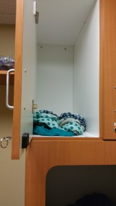 The fun of getting a mammogram starts with stuffing top wear into a locked cubby. Photo by Teresa TL Bruce